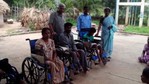 Differently Abled receive wheel chairs